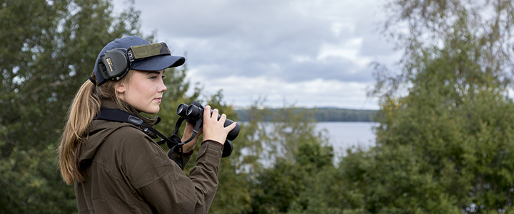 Lapua hunting ammunition girl with binoculars